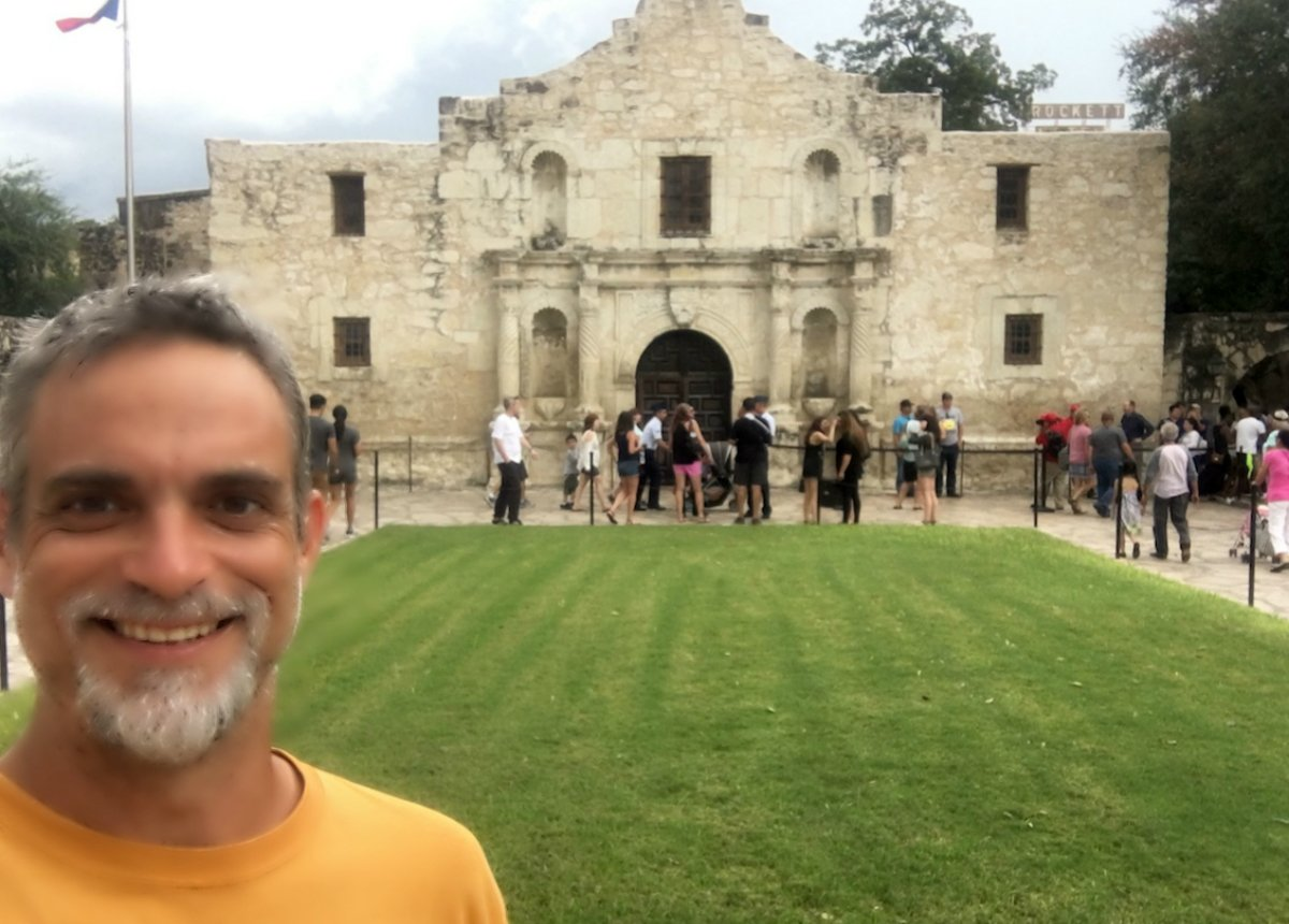 Image of Mark McGuire in front of the Alamo in San Antonio, Texas