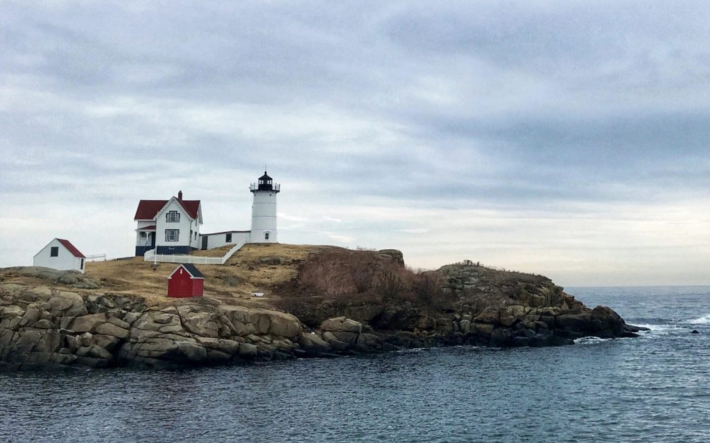 Nubble Lighthouse on a semi-cloudy day.